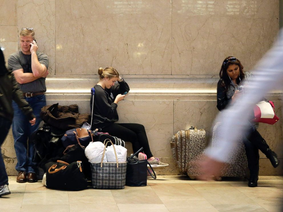 PHOTO: Holiday travelers at Grand Central Terminal wait to board trains to Connecticut, Nov. 25, 2014, in New York.