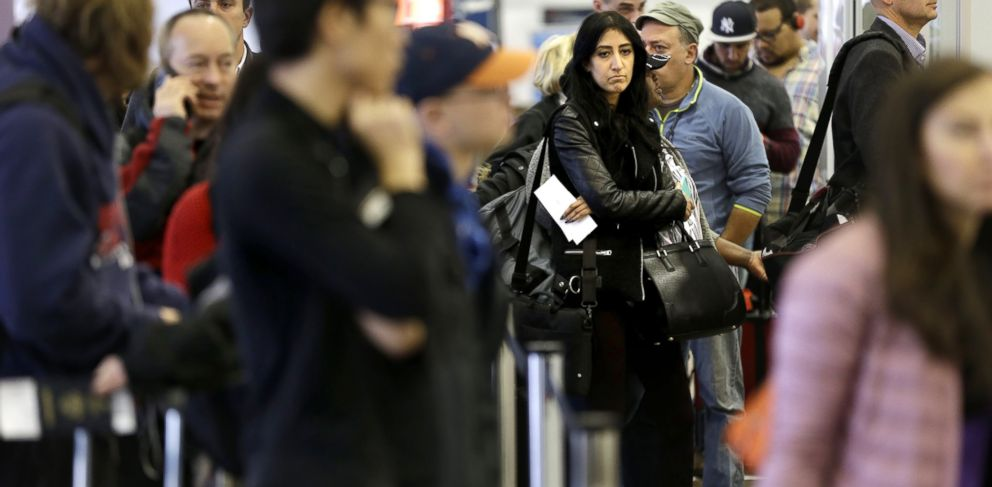 PHOTO: Travelers wait in lines to pass through security and get to their gates at LaGuardia Airport in New York, Nov. 25, 2014.