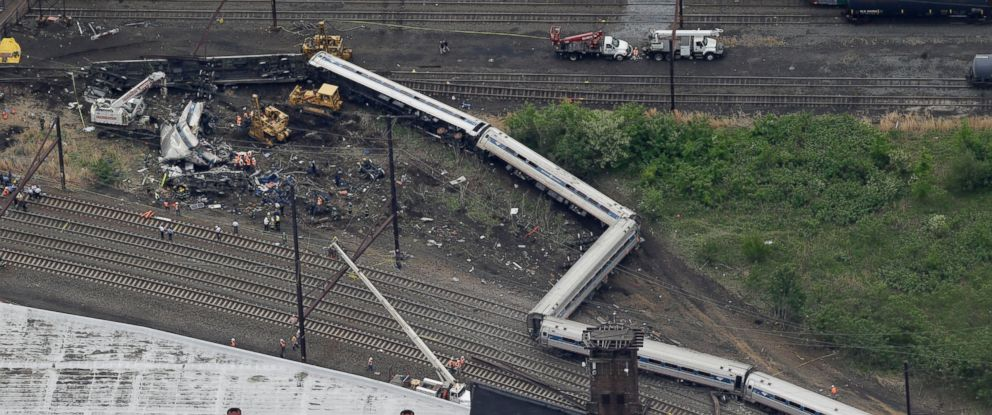 PHOTO: Emergency personnel work at the scene of a deadly train derailment, May 13, 2015, in Philadelphia.