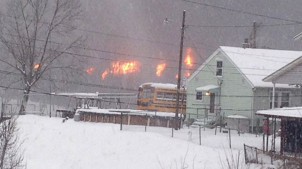 PHOTO: A fire burns, Feb. 16, 2015, after a train derailment near Charleston, W.Va.