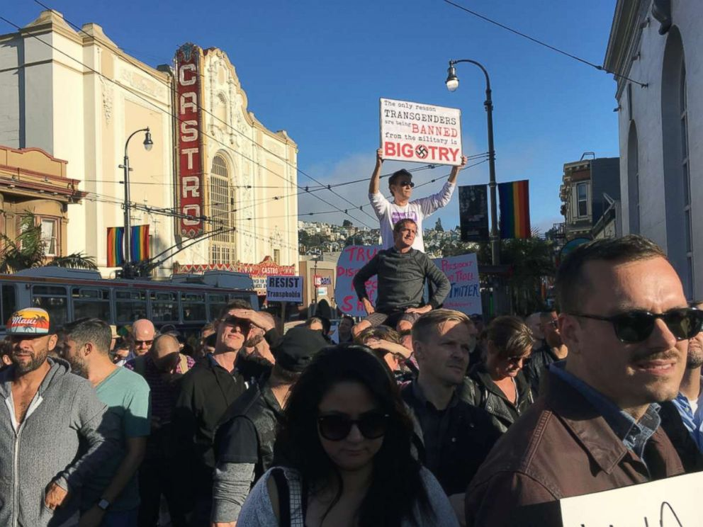 PHOTO: Protesters listen to speakers at a demonstration against a proposed ban of transgendered people in the military in the Castro District, Wednesday, July 26, 2017, in San Francisco.