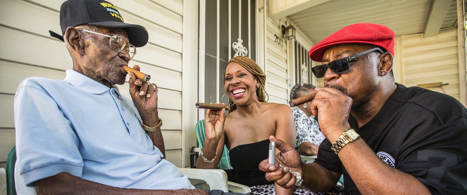 PHOTO: Richard Overton, left, smokes a cigar with neighborhood friends Donna Shorts, center, and Martin Wilford, right, on May 3, 2015 in Austin, Texas.