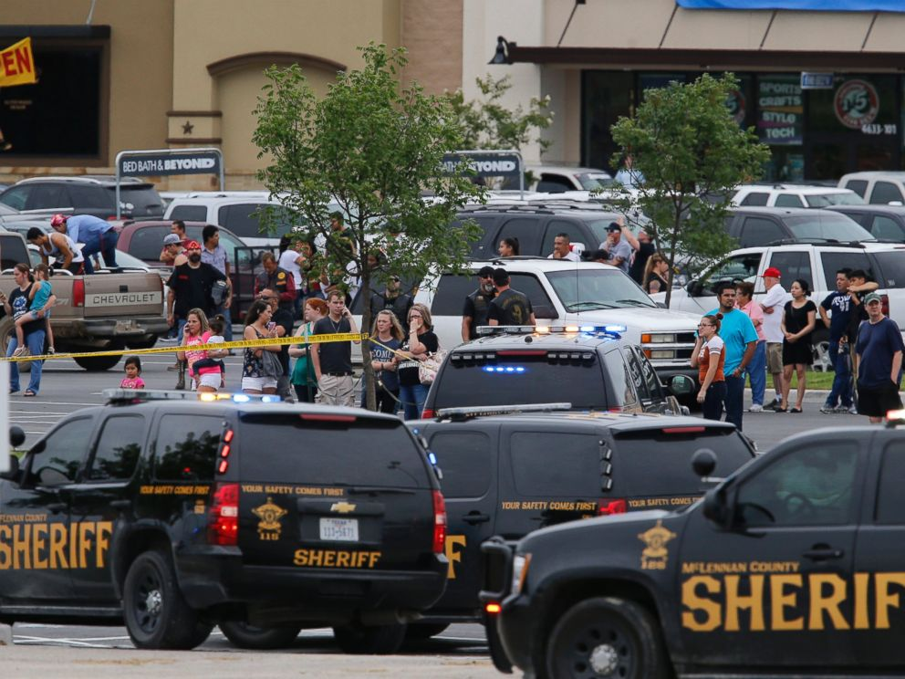 PHOTO: People at the Central Texas MarketPlace watch a crime scene near the parking lot of a Twin Peaks restaurant Sunday, May 17, 2015, in Waco, Texas.