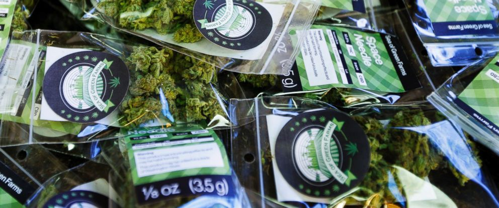 "PHOTO: Packets of a variety of recreational marijuana named ""Space Needle"" are shown during packaging operations at Sea of Green Farms in Seattle, July 1, 2014."