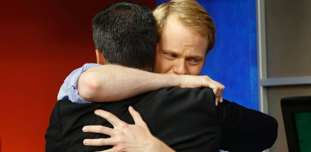 PHOTO: WDBJ-TV7 anchor Chris Hurst, right, hugs meteorologist Leo Hirsbrunner during the early morning newscast at WDBJ-TV7, in Roanoke, Va., Aug. 27, 2015.