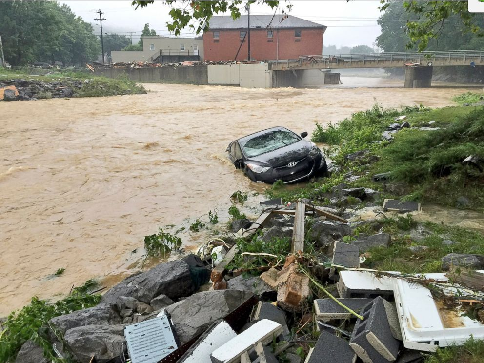 In this photo released by the The Weather Channel, a vehicle rests on ...