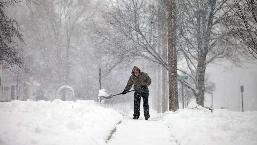 PHOTO: Snow builds up as a man