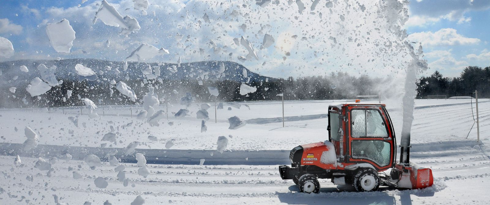 PHOTO: Williston Northampton School grounds manager Joe Zewinski clears snow