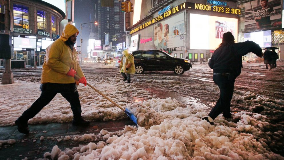 PHOTO: Snow is shoveled from a sidewalk in Times Square, Feb. 5, 2014, in New York City.