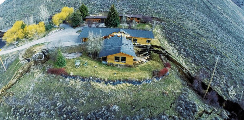 PHOTO: A home damaged by a landslide Friday, April 18, 2014 in Jackson, Wyo. is shown in this aerial image provided by Tributary Environmental.