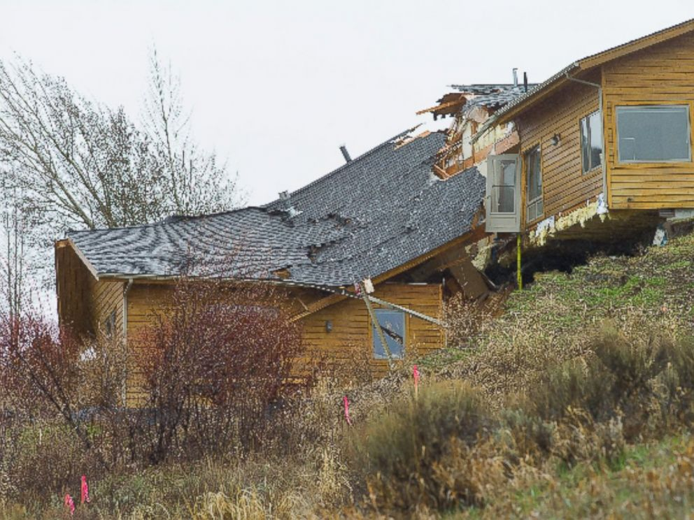 PHOTO: A house breaks apart as a slow-moving landslide in Jackson, Wyo. advances downhill on Friday, April 18. 2014.