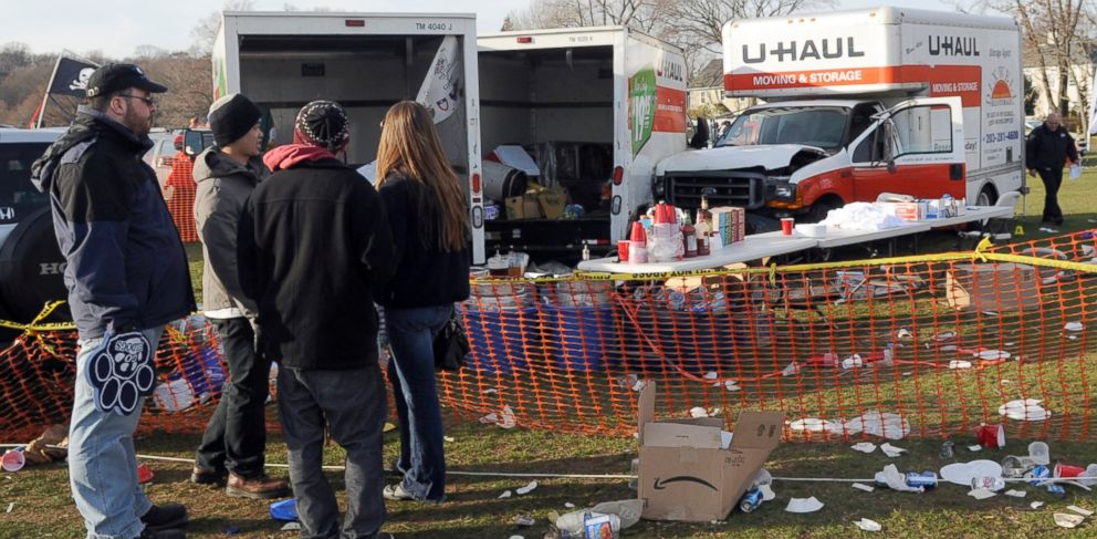 PHOTO: People look at the scene of a fatal accident in a parking area outside an NCAA college football game between Harvard and Yale, in New Haven, Conn., Nov. 19, 2011.