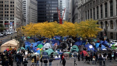 PHOTO: Occupy Wall Street tents are set-up under fall-colored trees in Zuccotti Park in New York, Nov. 13, 2011.