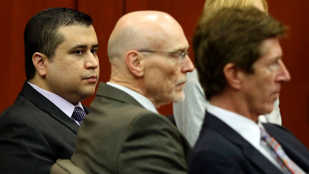 PHOTO: George Zimmerman, left, sits with his defense attorneys, Don West, cent