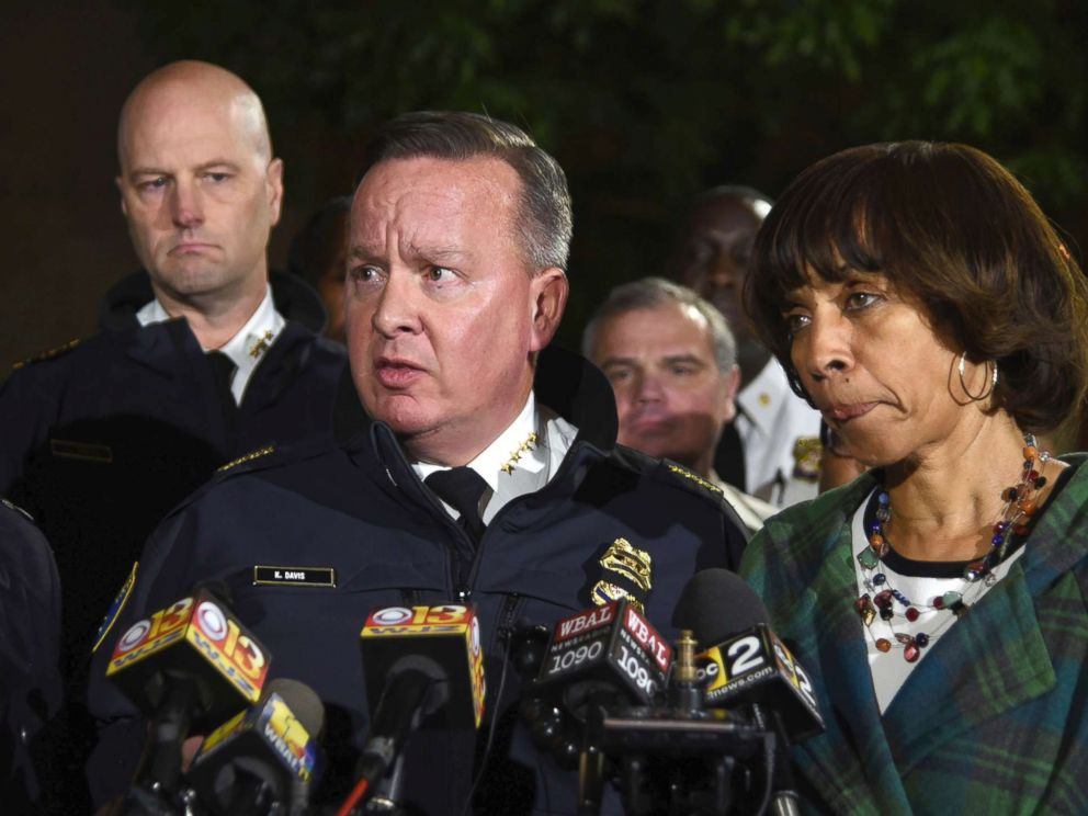 PHOTO: Police commissioner Kevin Davis, center, talks to the press after a police officer was shot, as States Attorney for Baltimore Marilyn Mosby, left, and Baltimore Mayor Catherine Pugh, right, stand nearby, Nov. 15, 2017, in Baltimore, Md.