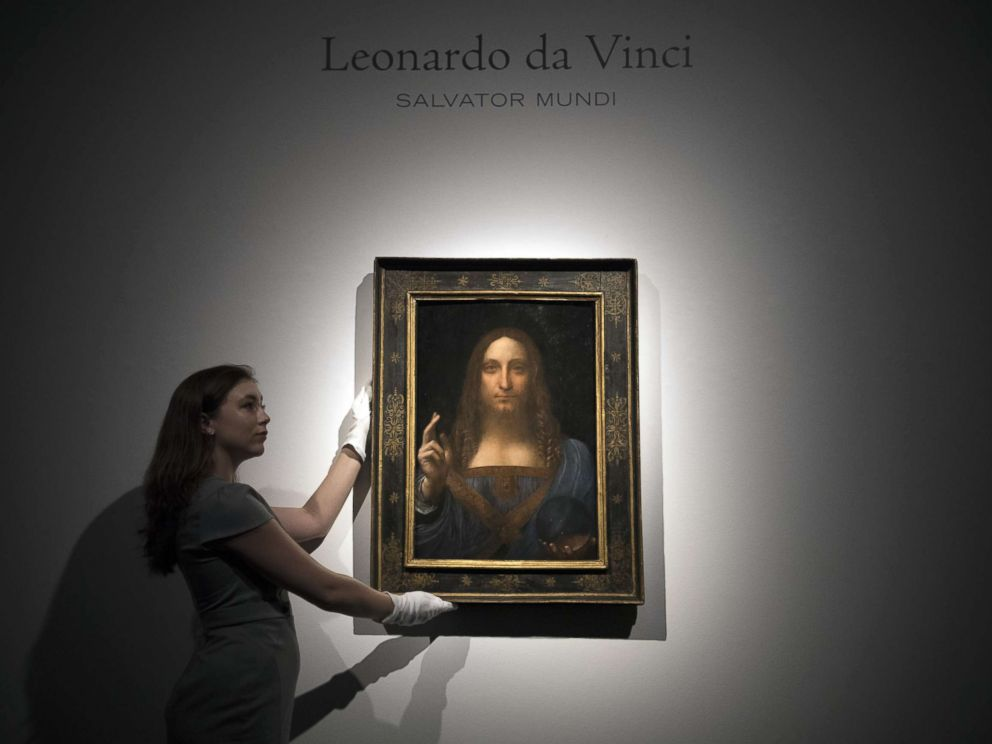 PHOTO: A staff member poses with a painting by Leonardo da Vinci entitled Salvator Mundi in London on OCt. 24, 2017, before it is auctioned in New York. The painting is the last privately owned Da Vinci and is expected to fetch around $100,000,000.