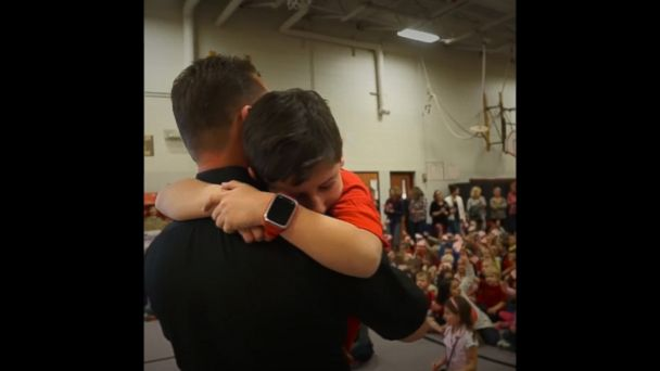 Colorado National Guard Army Master Sgt. surprises his young son at school assembly after returning home from 6-month deployment in Bahrain.
