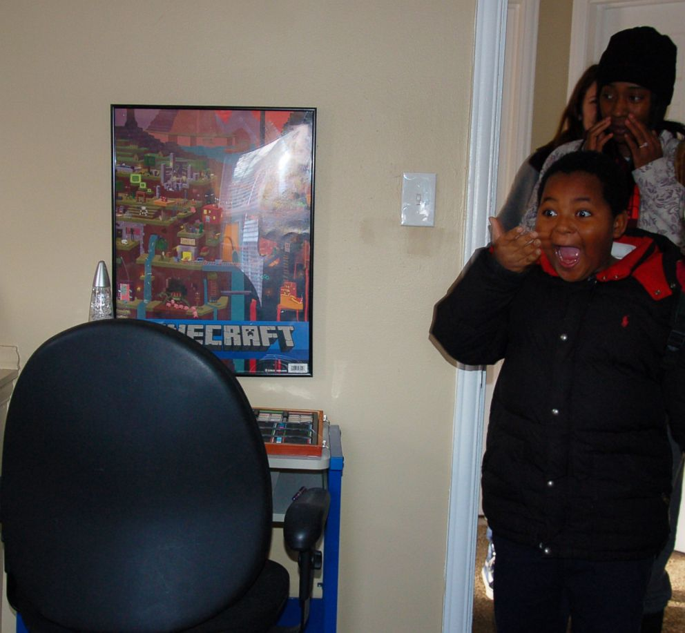 PHOTO: Daerye Neely, 8, of Detroit, could not contain his surprise seeing his newly furnished home. After the initial shock, he broke down in tears and hugged his mom Dec. 15, 2017.