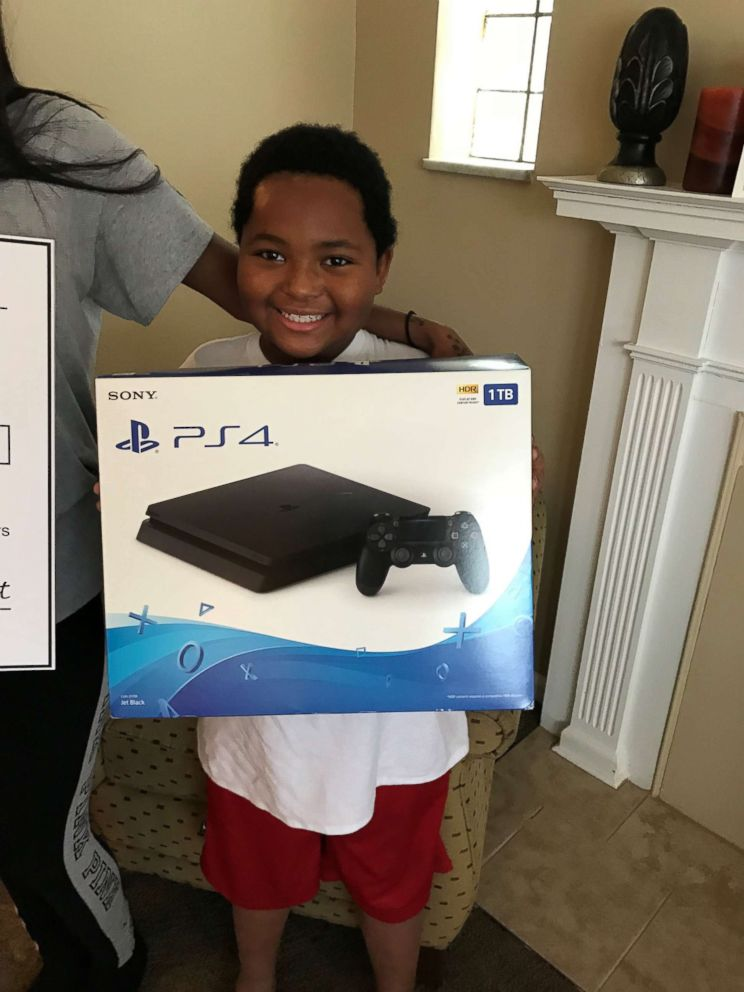 PHOTO: Daerye Neely was presented with a PlayStation 4 Jan. 12 by U-Haul and Humble Design.