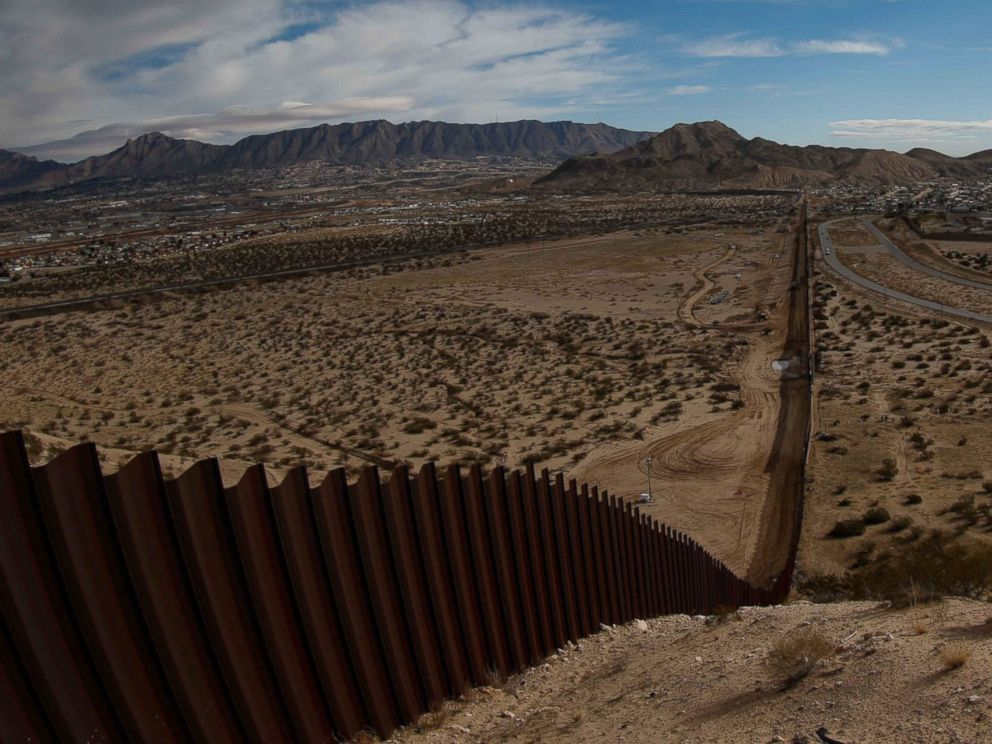 PHOTO: View of the border fence between the US states of Texas and New Mexico, left, and Ciudad Juarez, Mexico, right, on Jan. 25, 2017.