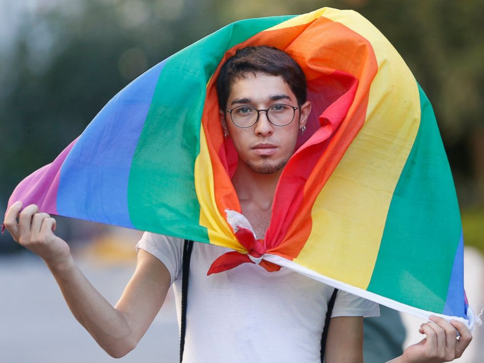 PHOTO: A participant walks with the rainbow flag during Istanbul LGTB Pride Parade which was cancelled due to security concerns by the governor of Istanbul, in Istanbul, June 25, 2017.
