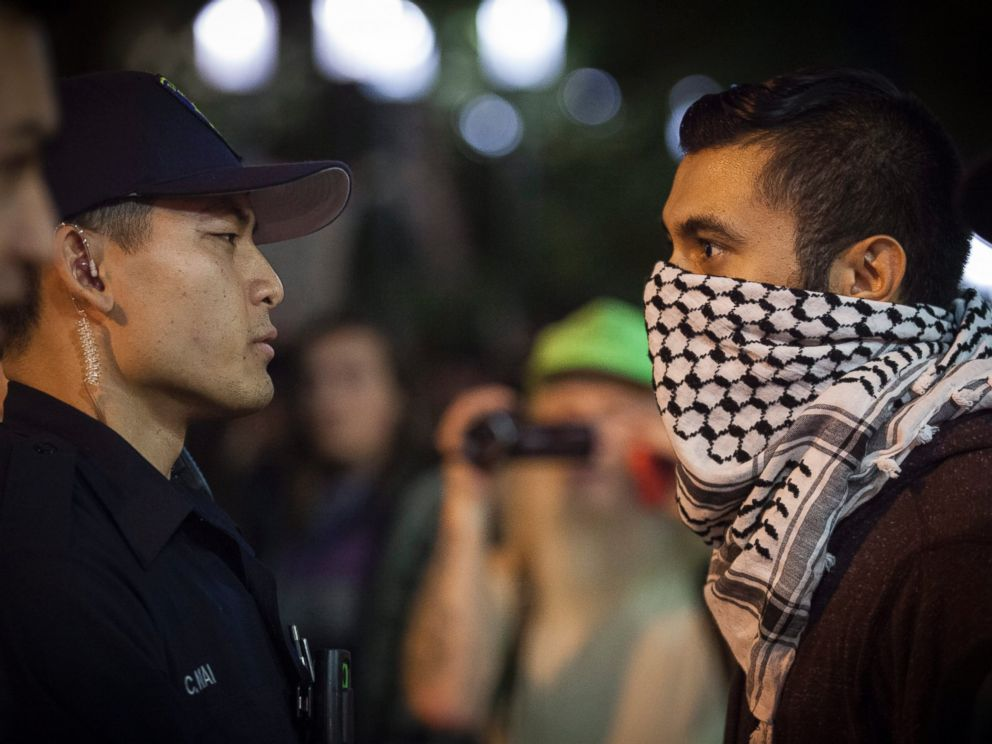 PHOTO: A demonstrator face off with police during a march through the streets in protest against President-elect Donald Trump in Oakland, California, Nov. 10, 2016.