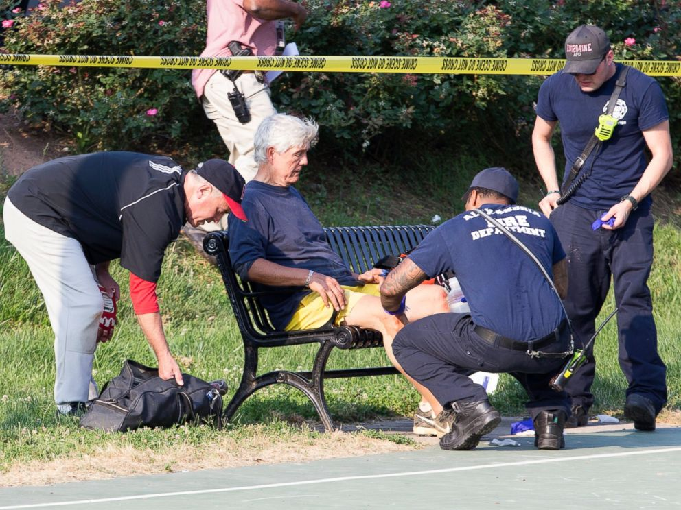 PHOTO: A man receives medical attention from first responders on the scene following a shooting in Alexandria, Va., June 14, 2017.