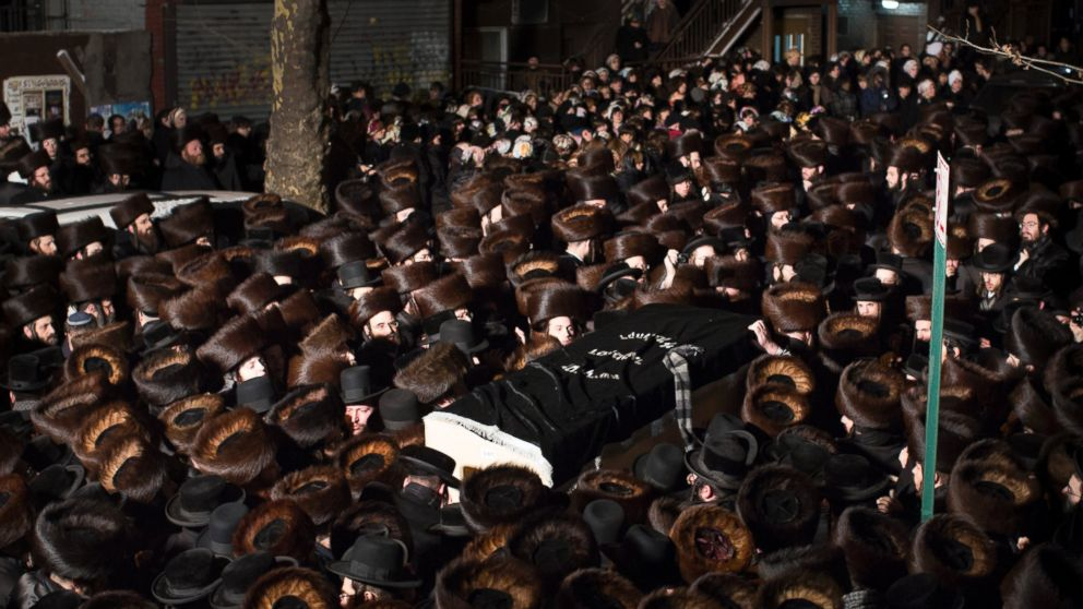PHOTO: A handout picture made available by Insider Images shows mourners carrying the coffin of Menachem Stark at his funeral in Brookl