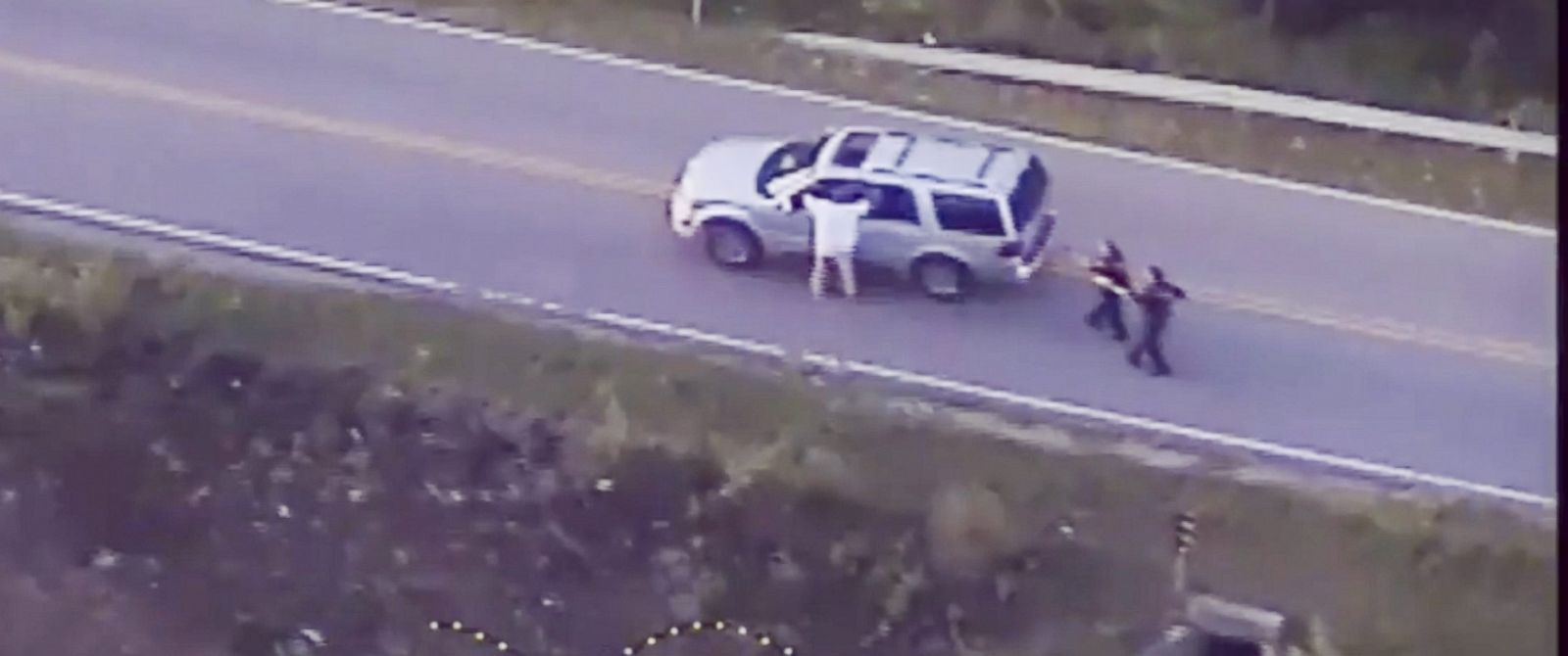 PHOTO: A frame grab from video released by the Tulsa, Oklahoma, Police Department and acquired on Sept. 20, 2016, reportedly shows Terrence Crutcher walking with his hands in the air as he is confronted by police in Tulsa, Oklahoma, on Sept. 16, 2016.