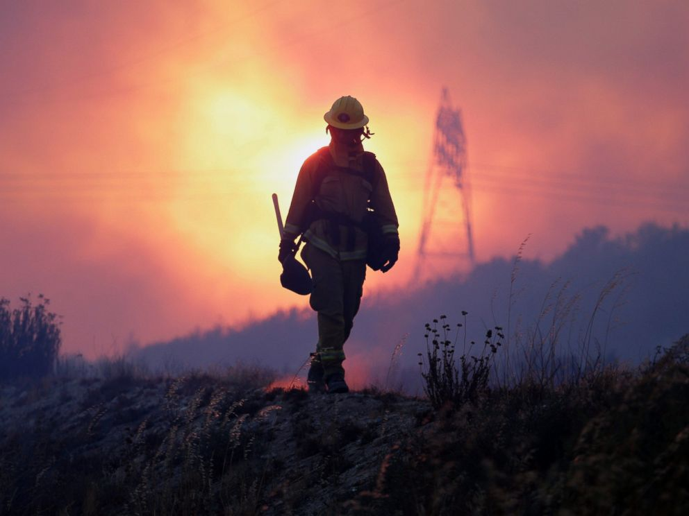 PHOTO: A firefighter keeps an eye on the Blue Cut fire line, north of Los Angeles, California, Aug. 16, 2016.