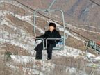 PHOTO: North Korean leader Kim Jong-un aboard a ski lift during his inspection tour at the Masi
