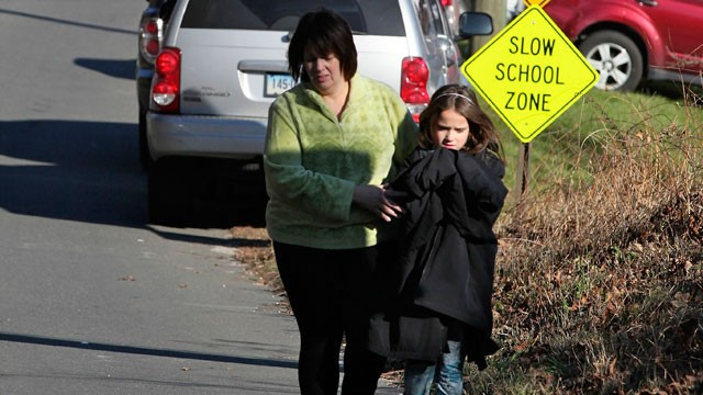 PHOTO: A parent and child leave the scene of the Sandy Hook Elementary School following a shooting inside the school in Newtown, Connecticut, on December 14, 2012.