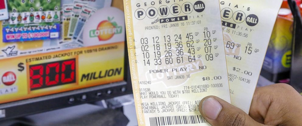PHOTO: A customer shows his tickets for the multi-state Powerball lottery jackpot, the largest in US history, at a convenience store in Madison, Georgia, Jan. 8, 2016.