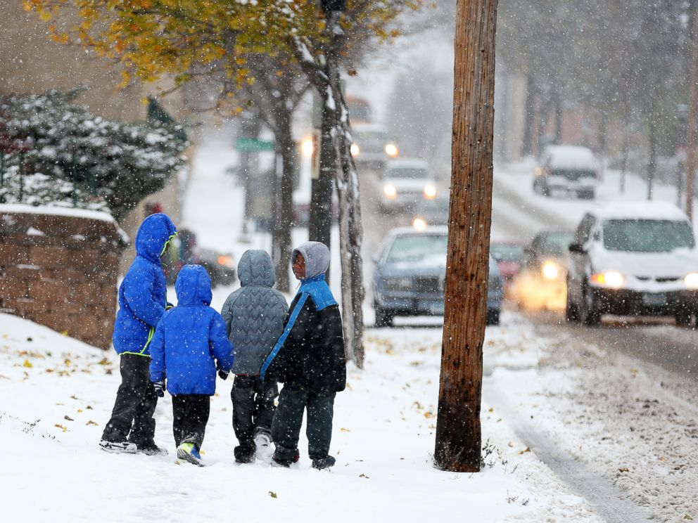 PHOTO: Children walk to school in St. Paul, Minn., during the first snowstorm of the season, Nov. 10, 2014.