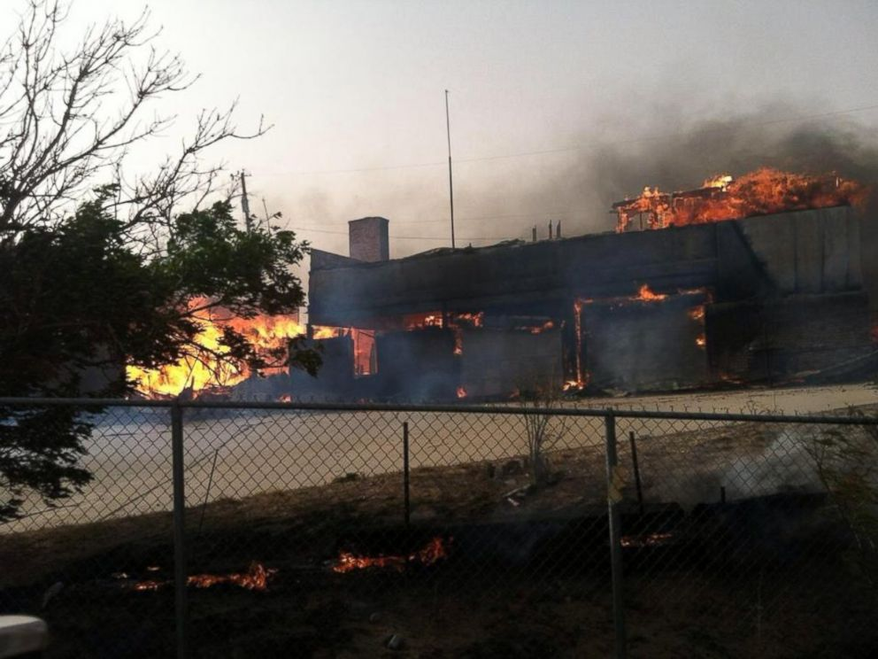 PHOTO: Fire damages a building in Hutchinson County, Texas, May 11, 2014.