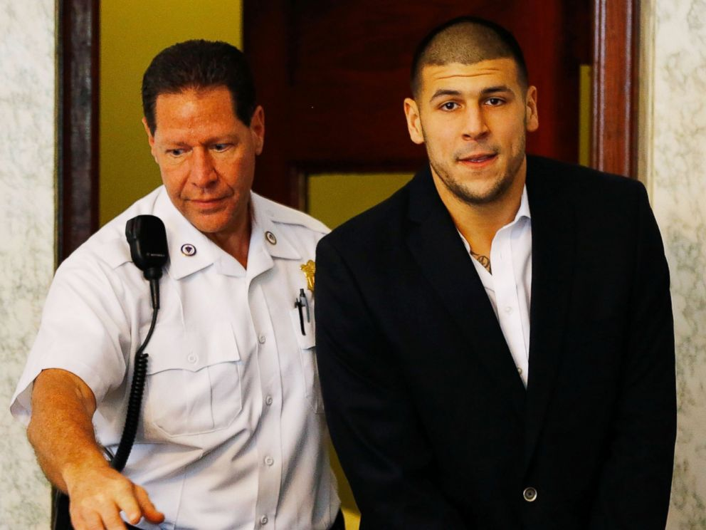 PHOTO: Aaron Hernandez is escorted into the courtroom of the Attleboro District Court for his hearing, on Aug. 22, 2013, in North Attleboro, Mass.