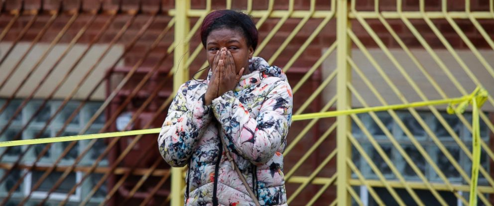 PHOTO: A woman grieves as she reacts to a shooting that left four people dead at a restaurant in the 2700 block of East 75th Street, on March 30, 2017, in Chicago.