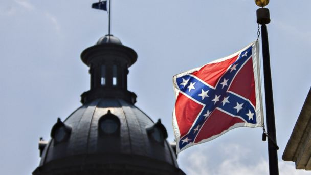 PHOTO: The Confederate Battle Flag flies in front of the South Carolina House in the state capitol, June 25, 2015, in Columbia, S.C. before it was taken down after the deadly shooting at Emanuel African Methodist Episcopal Church by Dylann Roof.