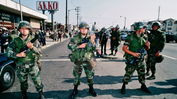 PHOTO: Armed National Guard soldiers hold a line in front of a post office in South Central Los Angeles, after several days of rioting due to the acquittal of the LAPD officers who beat Rodney King, May 1, 1992.