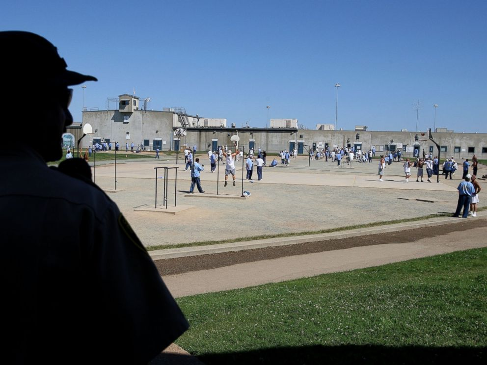 PHOTO: A California Department of Corrections officer looks on as inmates at the Mule Creek State Prison exercise in the yard August 28, 2007 in Ione, California