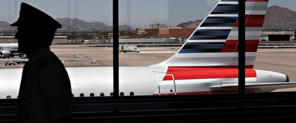 PHOTO: A pilot walks through the airport, May 24, 2016, in Phoenix.