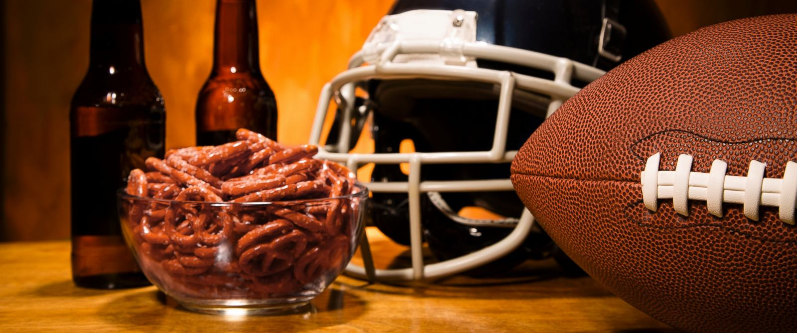 PHOTO: Football helmet and football on table with pretzels and beer. Superbowl party!