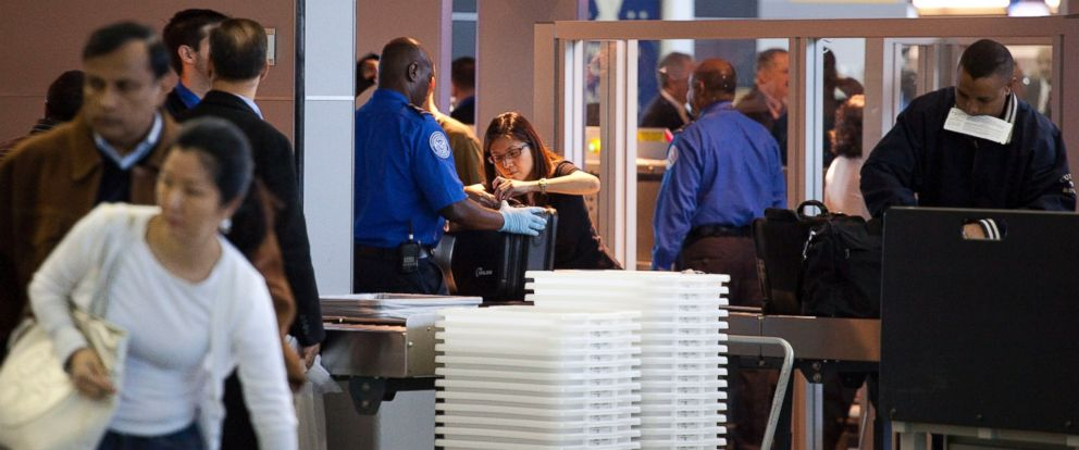 PHOTO: Passengers pass through the passenger security checkpoint at John F. Kennedy International Airport on October 22, 2010 in the Queens borough of New York City.