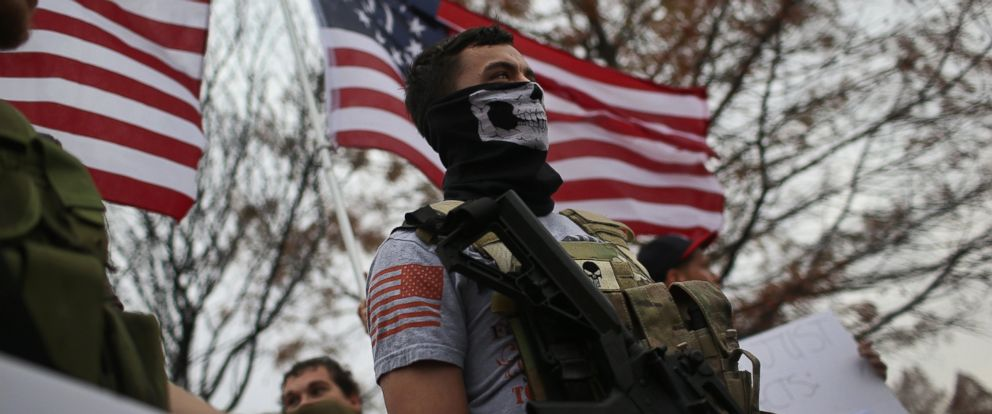 PHOTO: Armed protesters from the Bureau of American-Islamic Relations (BAIR), stage a demonstration in front of the Islamic Association of North Texas at the Dallas Central Mosque, Dec. 12, 2015, in Richardson, Texas.