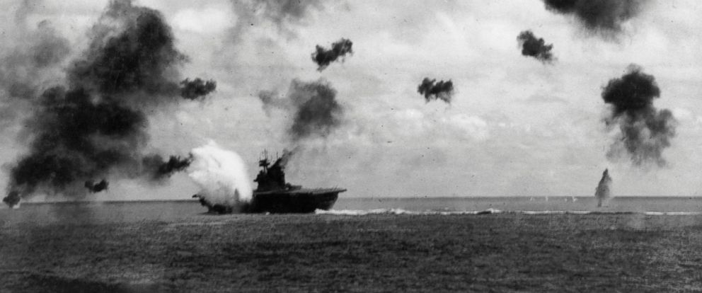 PHOTO: The American aircraft carrier USS Yorktown takes a hit while being bombed in the Battle of Midway, June 1942.
