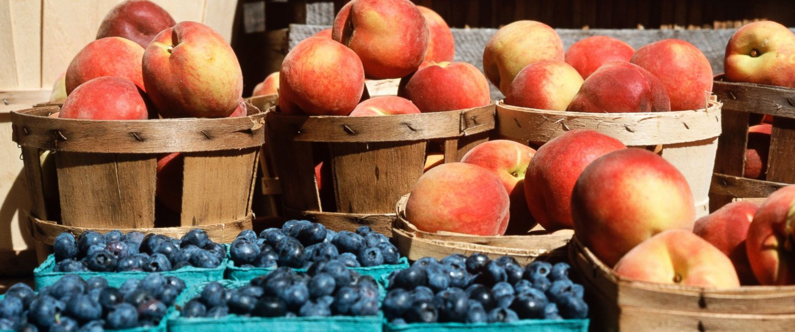 PHOTO: Blueberries and peaches at a fruit stand.