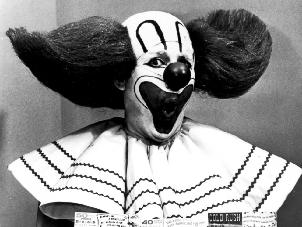 PHOTO: Bozo the Clown holding boxes of Bozo Express Bazooka bubble gum, circa 1965.