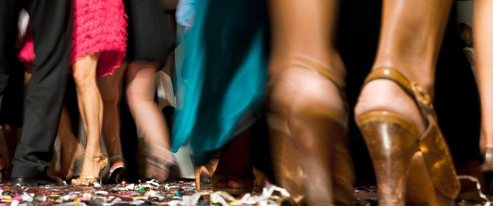PHOTO: People dance at a party.