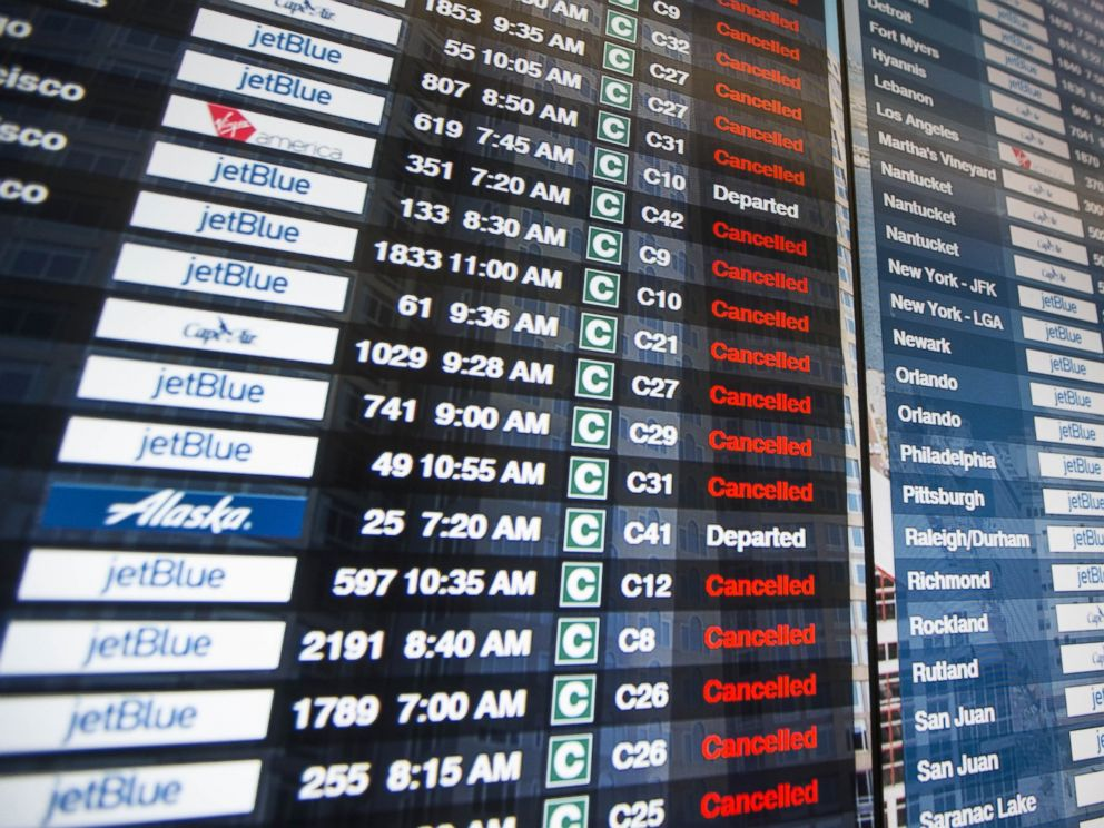 PHOTO: The information board in Terminal C at Logan International Airport shows the majority of flights cancelled, March 14, 2017, in Boston.