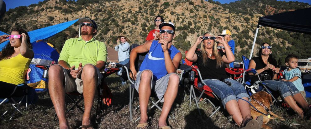 "PHOTO: People react as they see the perfect ""ring of fire"" as they watch an annular solar eclipse in Kanarraville, Utah, May 20 2012."